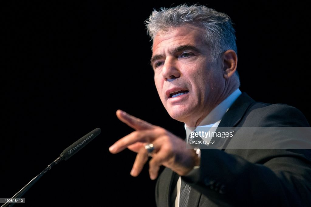 Israeli MP and chairperson of centre-right Yesh Atid party, Yair Lapid delivers a speech during an Economic Conference on December 24, 2014 in the Israeli Mediterranean Coastal city of Tel Aviv. AFP PHOTO / JACK GUEZ