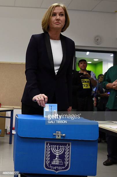 Israeli MP and coleader of the Zionist Union party Tzipi Livni casts her vote at a polling station in Tel Aviv on March 17 2015 Voting polls opened...