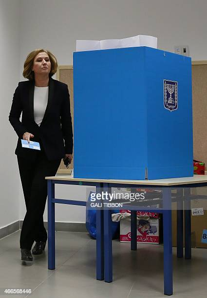 Israeli MP and coleader of the Zionist Union party Tzipi Livni prepares to cast her vote at a polling station in Tel Aviv on March 17 2015 Voting...
