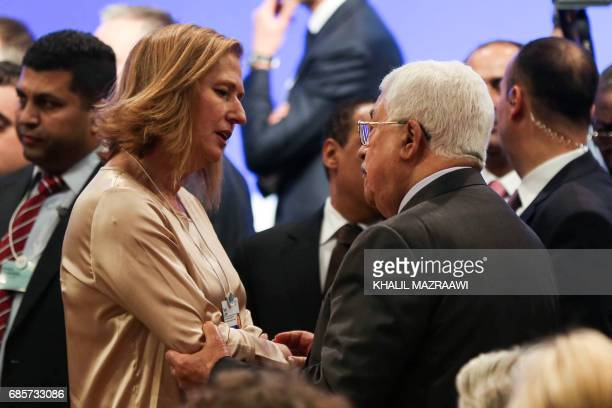 Israeli MP Tzipi Livni speaks with Palestinian president Palestinian president Mahmud Abbas during the opening session of the World Economic Forum...