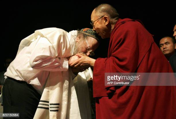 Israeli musican David Lewis kisses the hand of the Dalai Lama Tibet's exiled spiritual leader during a meeting with social activists in Jerusalem 16...