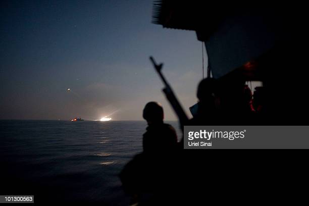 Israeli Navy soldiers stand guard on a missile ship as the Israeli Navy intercepts peace boats bound for Gaza on May 31 2010 in the Mediterranean sea...