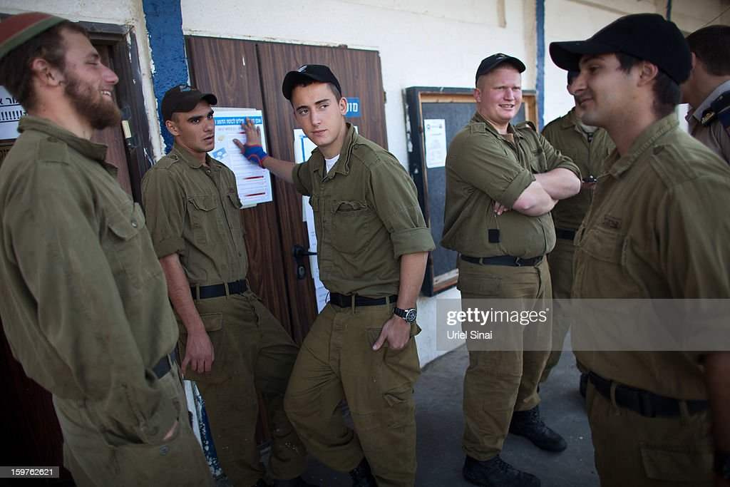 OUT] Israeli Navy soldiers wait to cast votes at an army Navy base on January 20, 2013 in Ashdod, Israel. Israeli soldiers have voted ahead of the Israeli general elections that will be held on January 22. The IDF votes before the rest of the country to make sure that every soldier has a chance to cast a ballot.