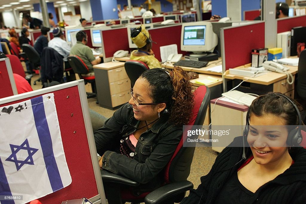 Israeli phone operators all with Englishspeaking backgrounds fill rows of desks through the night as they try to convince American Online members to...