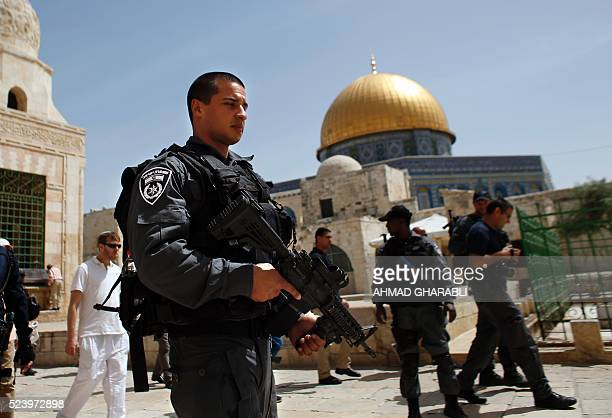 Israeli police accompany Jews past the Dome of the Rock mosque during a visit to the AlAqsa mosque compound in the Old City of Jerusalem on April 25...