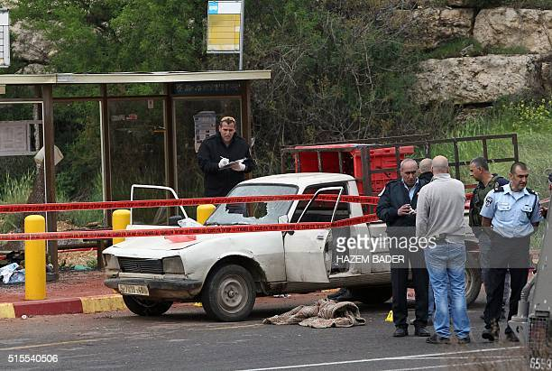 Israeli police and forensics check the scene where three Palestinians carried out two attacks a shooting and a car ramming on Israelis at the...