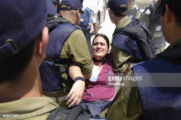 Israeli police and soldiers remove a settler from the Tel Katifa settlement in the Gaza strip Israel Wednesday August 17 2005 Israel today began...