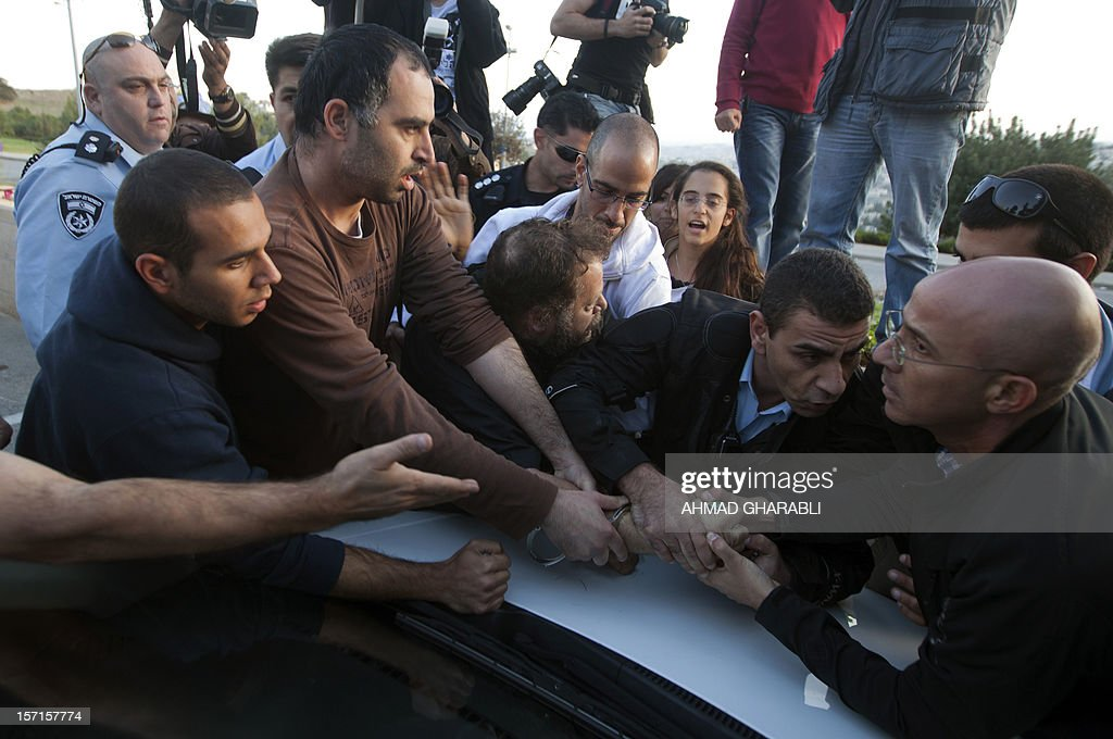 Israeli police arrest one man for attempting to burn a Palestinian flag on November 29, 2012 as a handful of ultra-nationalist Israelis led by two members of the Knesset (Israeli Parliament) stage a rally protesting the Palestinian bid to upgrade their UN status outside the UN's headquarters in Jerusalem. UN leader Ban Ki-moon warned ahead of key vote on UN recognition of a Palestinian state that the Middle East peace process is on 'life support'.