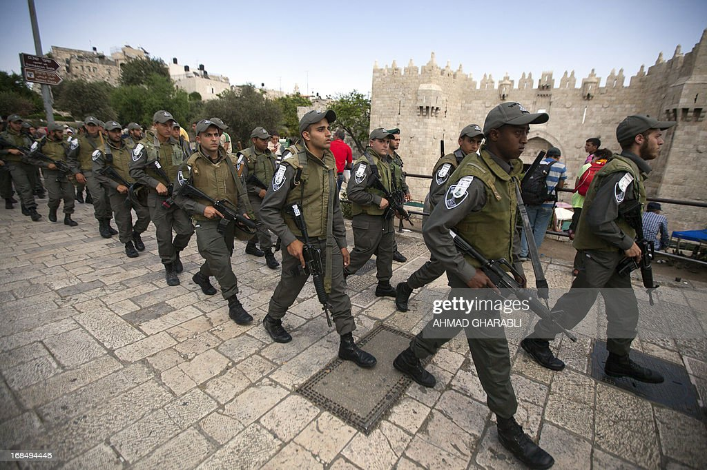 Israeli police arrive outside the Damascus Gate in Jerusalem's Old City on May 10, 2013. Jerusalem police were holding five ultra-Orthodox Jewish men who tried to disrupt landmark prayers by women Jewish activists at the Western Wall plaza in the Holy City.