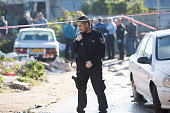 Israeli police attend the scene of a stabbing attack on January 21 2015 in Tel Aviv Israel At least 10 people have been injured in a stabbing attack...