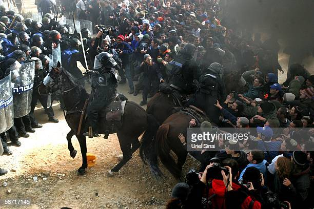 Israeli police clash with Israeli settlers February 1 2006 in the West Bank outpost of Amona The residents of Amona compose one of eightyseven...