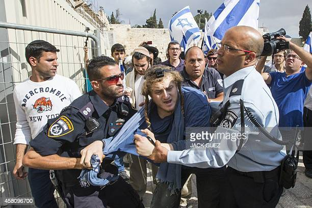 Israeli police detain a rightwing Israeli settler who was trying to jump a barrier to cross into the alAqsa mosque compound Islam's third holiest...