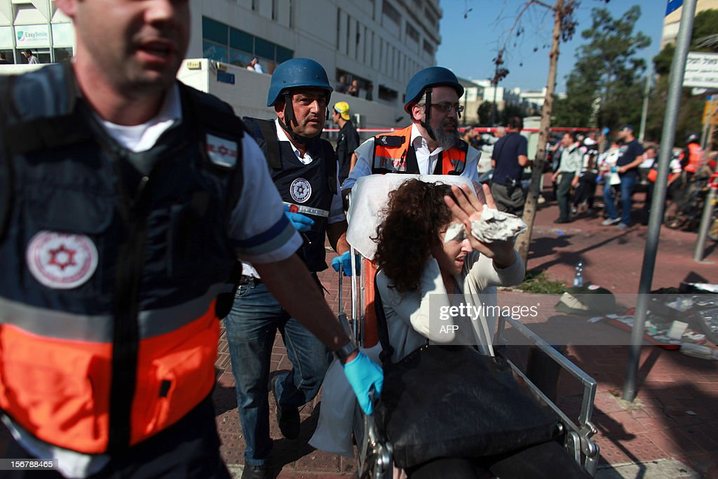 Israeli police evacuate wounded people after a blast ripped through a bus near the defence ministry in Tel Aviv on November 21, 2012. At least 10 people were injured in an explosion on a bus, Israel's emergency services said, in what an official said was 'a terrorist attack.'
