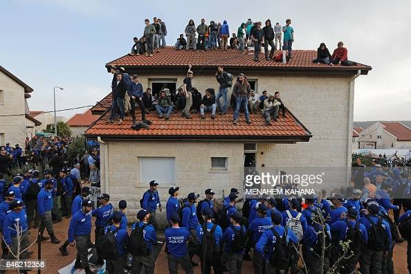 Israeli police forces arrive to evacuate Israeli supporters of settlements on February 28 2017 in the settlement of Ofra in the occupied West Bank...