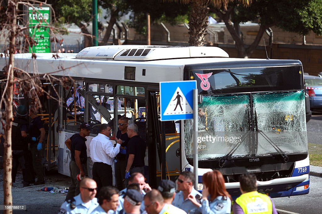 Israeli police gather after a blast ripped through a bus near the defence ministry in Tel Aviv on November 21, 2012. At least 10 people were injured in an explosion on a bus, Israel's emergency services said, in what an official said was 'a terrorist attack.'