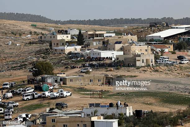 Israeli police gather in the Bedouin village of Umm alHiran which is not recognized by the Israeli government near the southern city of Beersheba in...