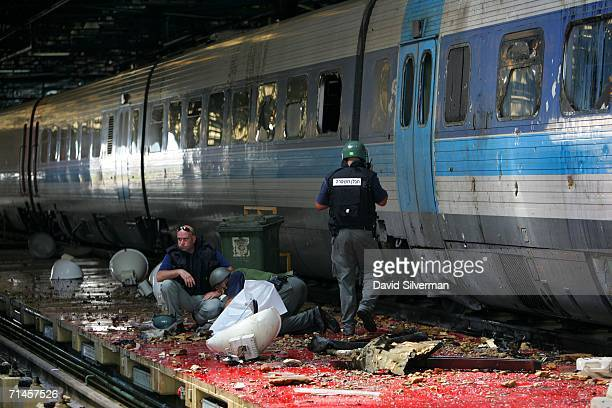 Israeli police inspect the impact point on a railway platform where a Hezbollah missile struck a railways depot July 16 2006 in the northern Israeli...