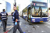 Israeli police inspect the scene of crime after a Palestinian attacker stabbed Israelis on a civilian bus in Tel Aviv Israel on January 21 2015 At...