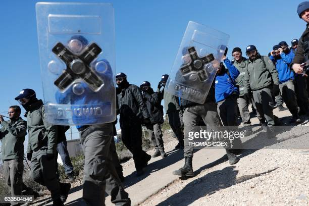 TOPSHOT Israeli police mobilise on the second day of an operation to evict residents from the West Bank settler outpost of Amona where hardline...