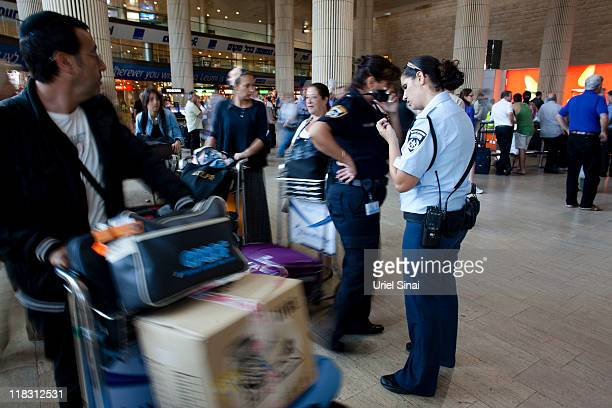 Israeli police officers deploy July 6 2011 at the Ben Gurion Airport in Israel Hundreds of 'ProPalestinian FlyIn' activists organised by Europeans...
