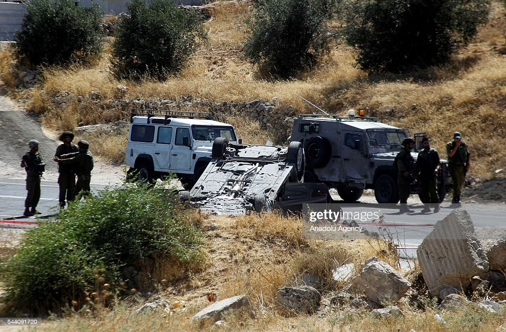 Israeli police officers inspect the scene after unidentified persons commence fire on moving vehicles near Otniel Israeli settlement in Hebron, West Bank on July 1, 2016. 1 Israeli killed and 2 of them were wounded.