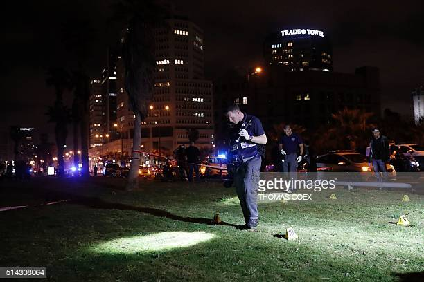 Israeli police officers look for evidences near the scene of a stabbing attack on March 8 2016 in the neighbourhood of Jaffa in the Israeli city of...