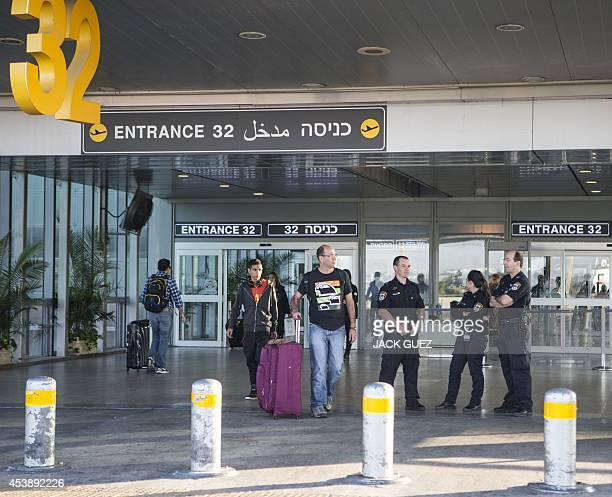 Israeli police officers stand guard at the terminal entrance of Ben Gurion International airport near the Mediterranean Israeli coastal city of Tel...