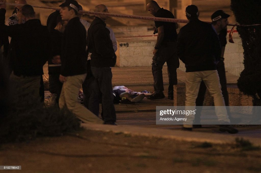 Israeli police officers stand next to the dead bodies of two Palestinian men who were shot dead by Israeli security forces after allegedly carrying firearm near Damascus Gate, a main entrance to Jerusalem's Old City on February 14, 2016.