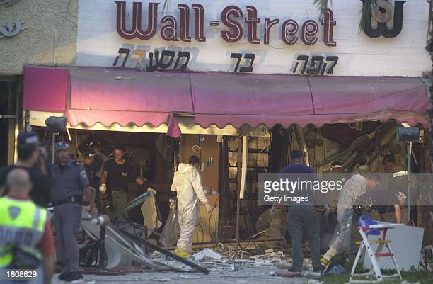Israeli Police search the scene where a Palestinian suicide bomber blew himself up August 12 2001 at a restaurant in Kiryat Motzkin near Haifa Israel...