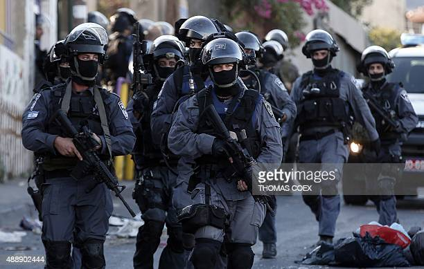 Israeli police special forces patrol a street in Jabel Mukaber a Palestinian neighbourhood of East Jerusalem as they search for Palestinian activists...