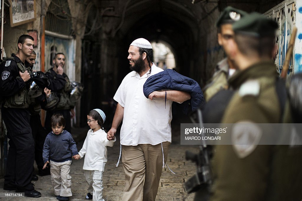 Israeli police stand guard as Israeli Jews leave the Temple Mount, known to the Palestinians as the al-Aqsa compound, in Jerusalem on March 27, 2013. Israeli police stopped far-right member of parliament, Moshe Feiglin, from entering the flashpoint holy site in Jerusalem fearing a violent response from Muslims at the site.