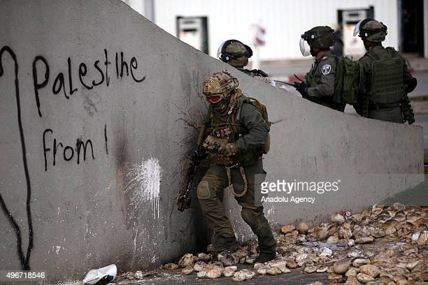 Israeli police stand guard as Palestinians protests Israeli government's violations on Jerusalem and WestBank in Beit Al neighborhood in Ramallah...