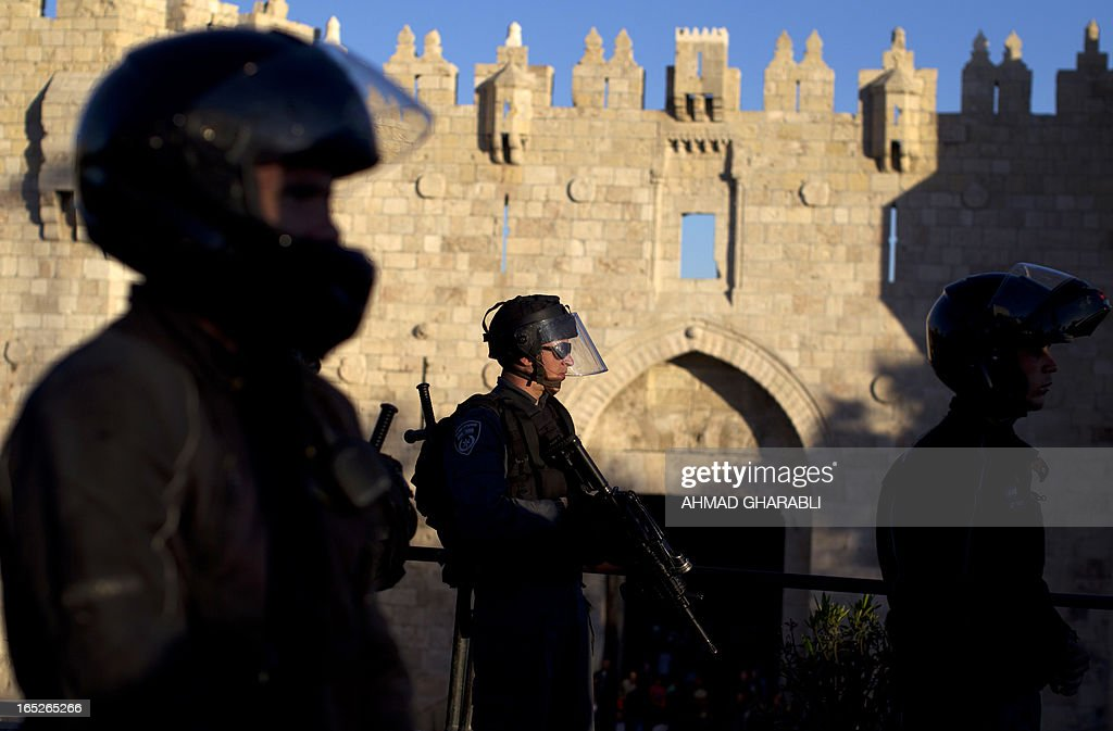 Israeli police stand guard in front of the Damascus Gate in Jerusalem's Old City, following clashes with Palestinian protesting the death of a Palestinian prisoner on April 2, 2013. The Palestinian leadership blamed Israel for the death of Maisara Abu Hamdiyeh, a long-term prisoner with cancer, hiking tensions over a tinderbox issue closely followed on the Palestinian street. AFP PHOTO/AHMAD GHARABLI