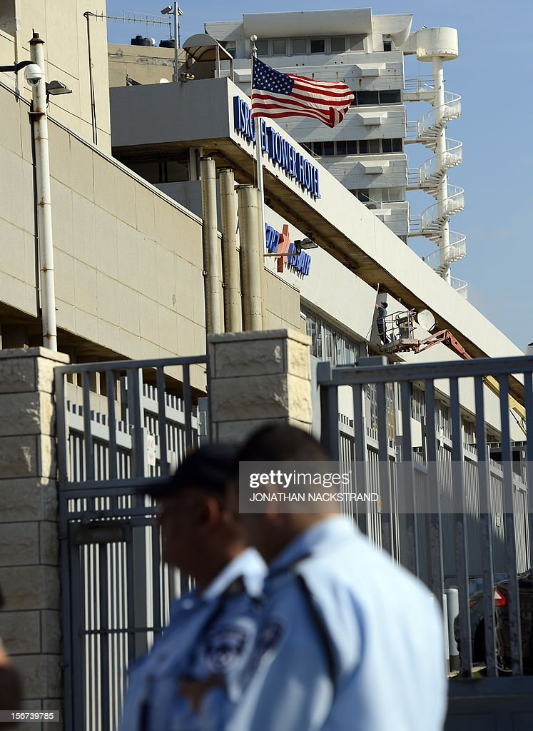 Israeli police surround the US embassy in Tel Aviv after one of the guards at the embassy was attacked and wounded with a knife and an ax on November 20, 2012. Security guards at the US embassy fired shots at a man who attacked them an Israeli police spokeswoman said, indicating the attacker had been apprehended. AFP PHOTO / JONATHAN NACKSTRAND