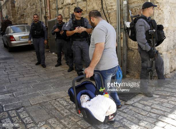 Israeli police take security measures in Old City of Jerusalem as Palestinians enter the Al Aqsa Mosque after all the gates of the Mosque were opened...