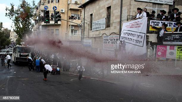Israeli police use a 'skunk' water cannon containing a malodorant substance to disperse UltraOrthodox Jews during a demonstration against compulsory...