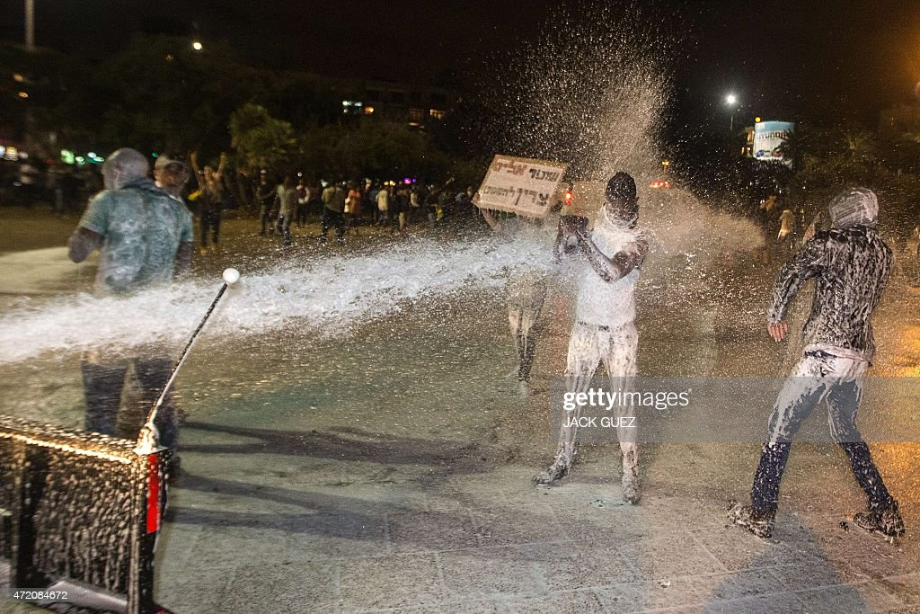 Israeli police uses water cannon during heavy clashes to disperse Ethiopian Israelis demonstrating in central Tel Aviv against alleged police...