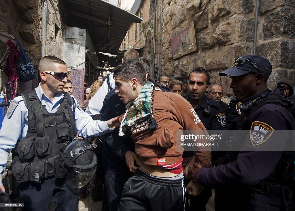 Israeli policemen arrest a Palestinian man in Jerusalem's old city, near Al-Aqsa mosque on February 25, 2013 after a group of Israeli settlers attempted to enter the compound on February 25, 2013. Palestinian president Mahmud Abbas said that Israel was deliberately seeking to stoke unrest in the occupied West Bank but that Palestinians would not be provoked. AFP PHOTO/AHMAD GHARABLI