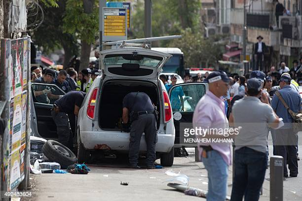 Israeli policemen inspect the car used by a Palestinian man who drove into a bus stop and carried out a stabbing attack in a Jerusalem ultraOrthodox...