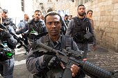 Israeli policemen secure the visit of Israeli MP and chairperson of the centerright Yesh Atid party Yair Lapid at the Lion Gate in Jerusalem's Old...