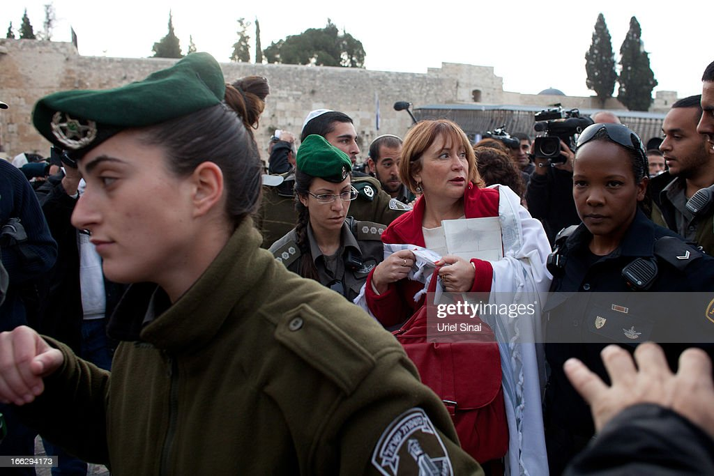 Israeli policewomen detain a member of the religious group 'Women of the Wall' wearing a 'Tallit' (traditional Jewish prayer shawl) during a prayer marking the first day of the Jewish month of Iyar at the Western Wall on April 11, 2013 in Jerusalem's Old City, Israel. Five members of the organisation 'Women of the Wall' were detained by police during the group's monthly prayer at the Western Wall, after covering themselves with prayer shawls in contradiction to the holy site's custom.