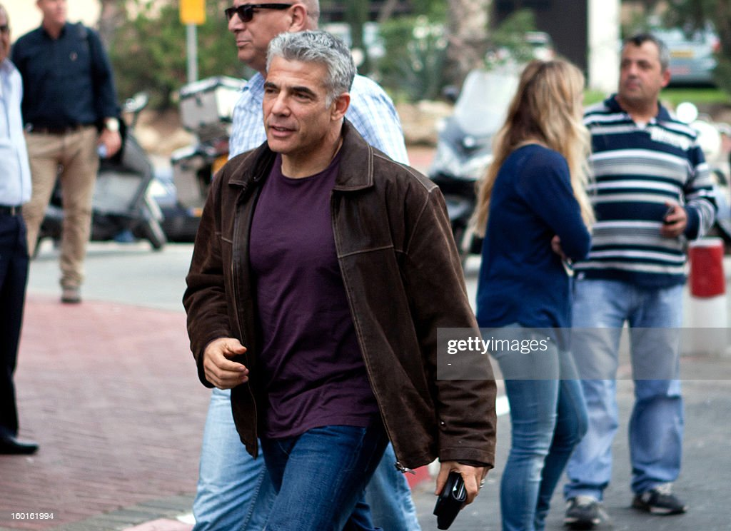 Israeli politician Yair Lapid arrives at the Yesh Atid headquarters in Tel Aviv January 27, 2013, for a party meeting. Israeli Prime Minister Benjamin Netanyahu has offered Yesh Atid leader Yair Lapid, Israel's newest political star, the post of foreign minister or finance minister in a new government, a newspaper reported on January 25.