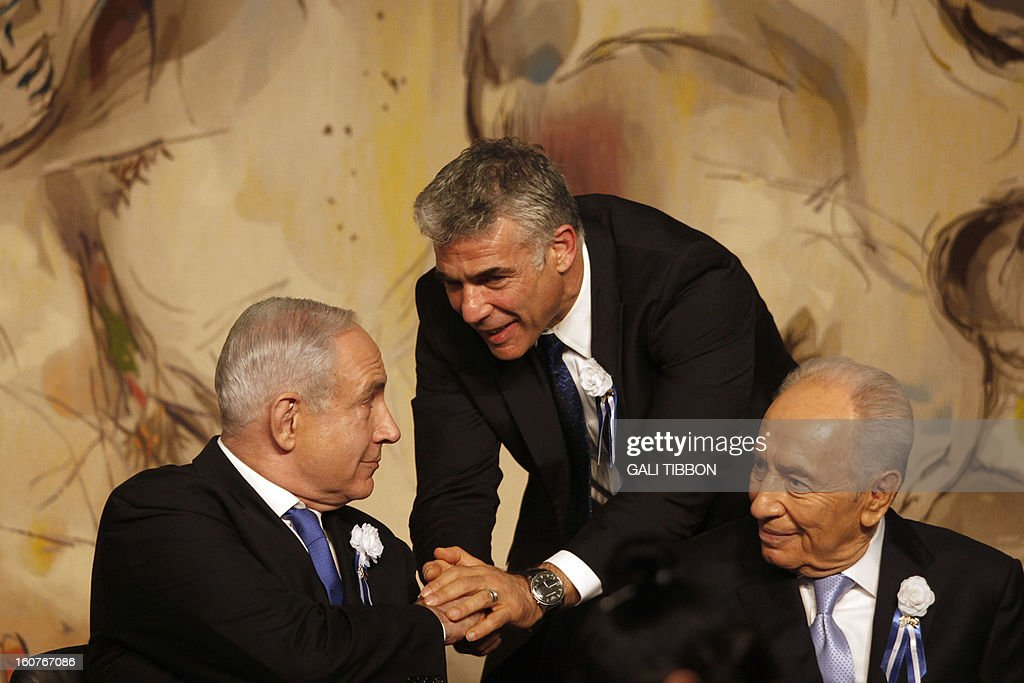 Israeli politician Yair Lapid (C), leader of the Yesh Atid party, shakes hand with Prime Minister Benjamin Netanyahu (L) as he sits next to President Shimon Peres during a reception marking the opening of the 19th Knesset (Israeli parliament) on February 5, 2013 in Jerusalem. Israeli Prime Minister Benjamin Netanyahu said a Bulgarian finding that Hezbollah was behind a deadly bombing in the country should push the EU to draw the 'necessary conclusions' about the group, hinting it should be placed on a terror watch list.