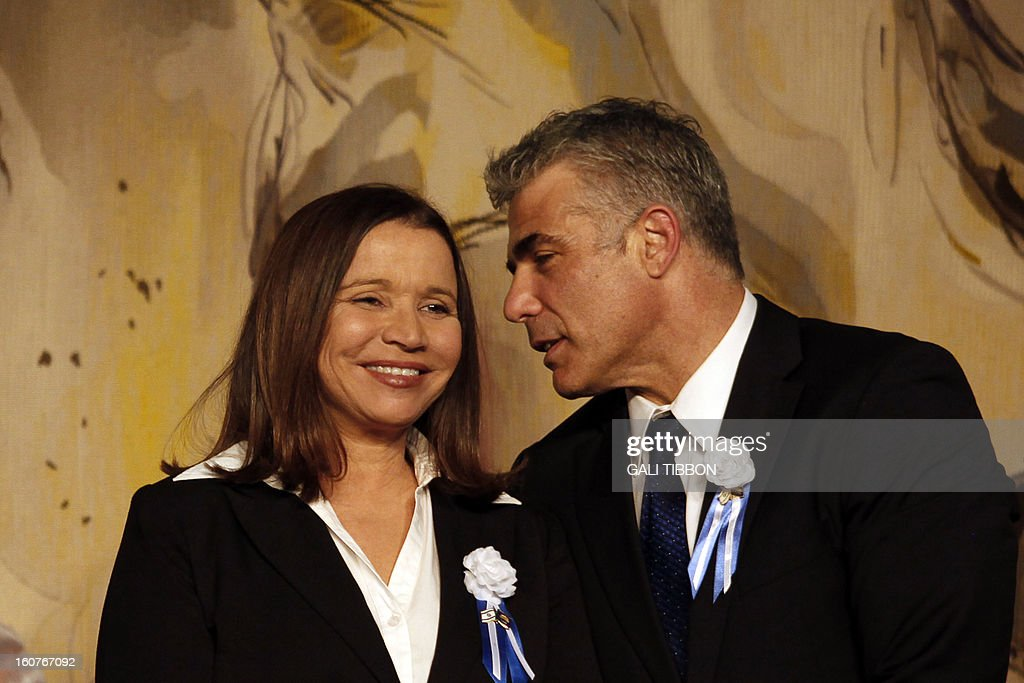 Israeli politician Yair Lapid (R), leader of the Yesh Atid party, speaks to Labor party leader Shelly Yachimovich during a reception marking the opening of the 19th Knesset (Israeli parliament) on February 5, 2013 in Jerusalem.