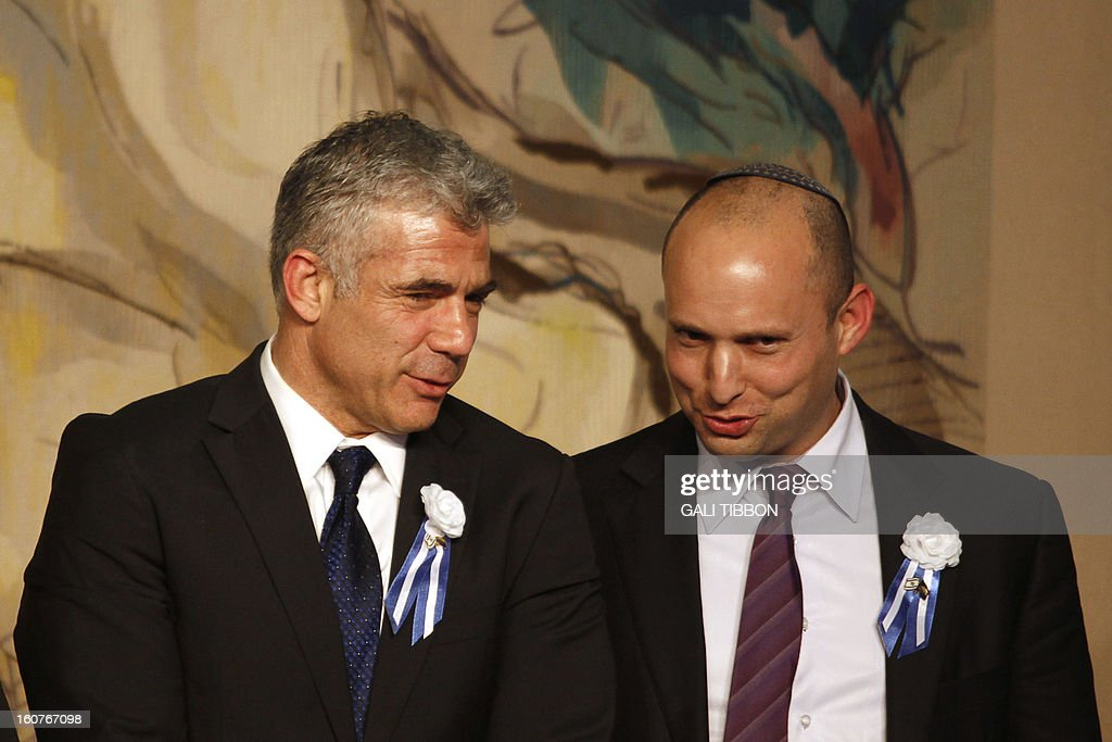 Israeli politician Yair Lapid (L), leader of the Yesh Atid party, speaks to Naftali Bennett, head of the Israeli hardline national religious party the Jewish Home during a reception marking the opening of the 19th Knesset (Israeli parliament) on February 5, 2013 in Jerusalem.