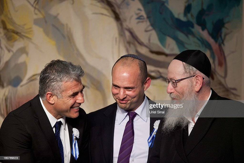 Israeli politician Yair Lapid (L), leader of the Yesh Atid party, speaks to Naftali Bennett, head of the Israeli hardline national religious party the Jewish Home (C) and Yaakov Litzman (R) head of the Agudat Yisrael Ultra orthodox party during a reception marking the opening of the 19th Knesset (Israeli parliament) on February 5, 2013 in Jerusalem, Israel. The 120 members of the Knesset included a record 48 new law makers.