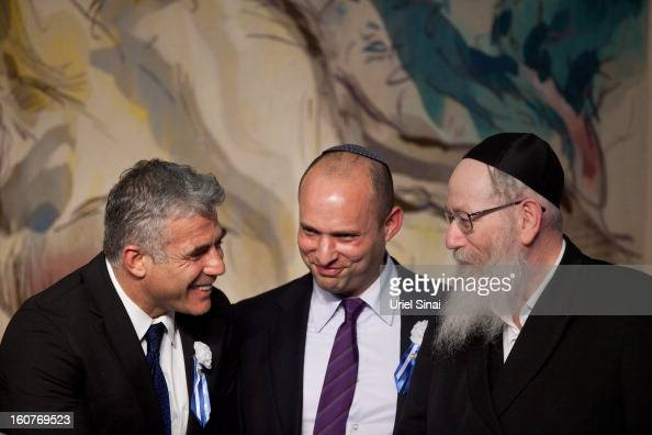 Israeli politician Yair Lapid leader of the Yesh Atid party speaks to Naftali Bennett head of the Israeli hardline national religious party the...
