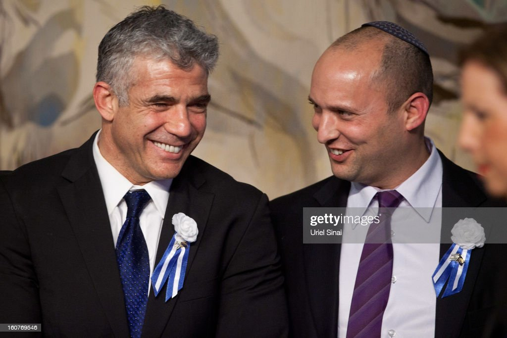 Israeli politician Yair Lapid (L), leader of the Yesh Atid party, speaks to Naftali Bennett, head of the Israeli hardline national religious party the Jewish Home during a reception marking the opening of the 19th Knesset (Israeli parliament) on February 5, 2013 in Jerusalem, Israel. The 120 members of the Knesset included a record 48 new law makers.