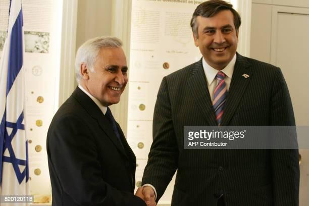 Israeli President Moshe Katsav shakes hand with Georgian President Mikheil Saakashvili prior to their meeting at his Jerusalem residence 01 November...