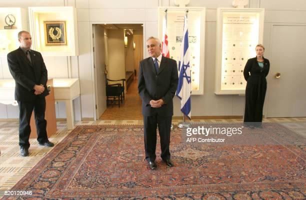 Israeli President Moshe Katsav stands waiting prior to meeting with Georgian President Mikheil Saakashvili at his Jerusalem residence 01 November...